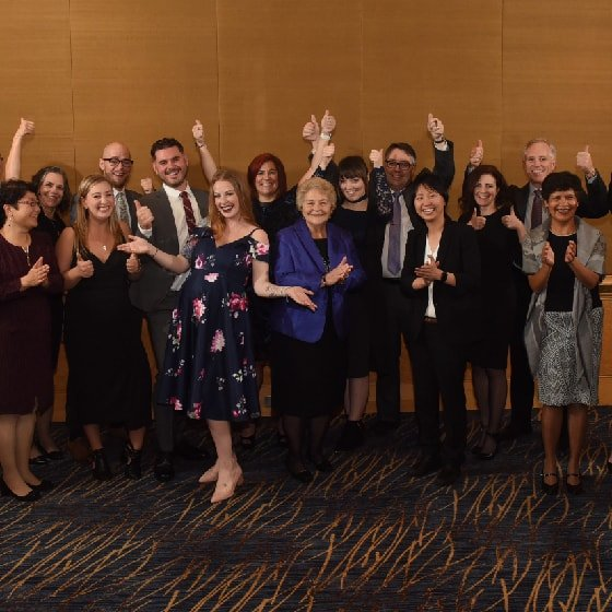 group shot of people with their thumbs up celebrating the 2017 Salute BC Gala